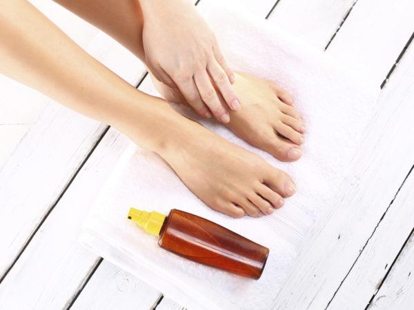 Beautiful slim female feet located on the towel