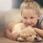An adorable little girl with her puppy  at homehttp://195.154.178.81/DATA/i_collage/pi/shoots/783492.jpg